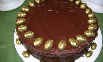 Chocolate Guinness Cake decorated with golden eggs for Easter.