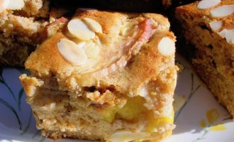 A square of peach and white chocolate cake.