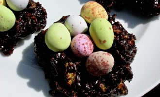 Crispy Crackolates aka Cornflake Cakes serving as Easter Nests complete with mini eggs.