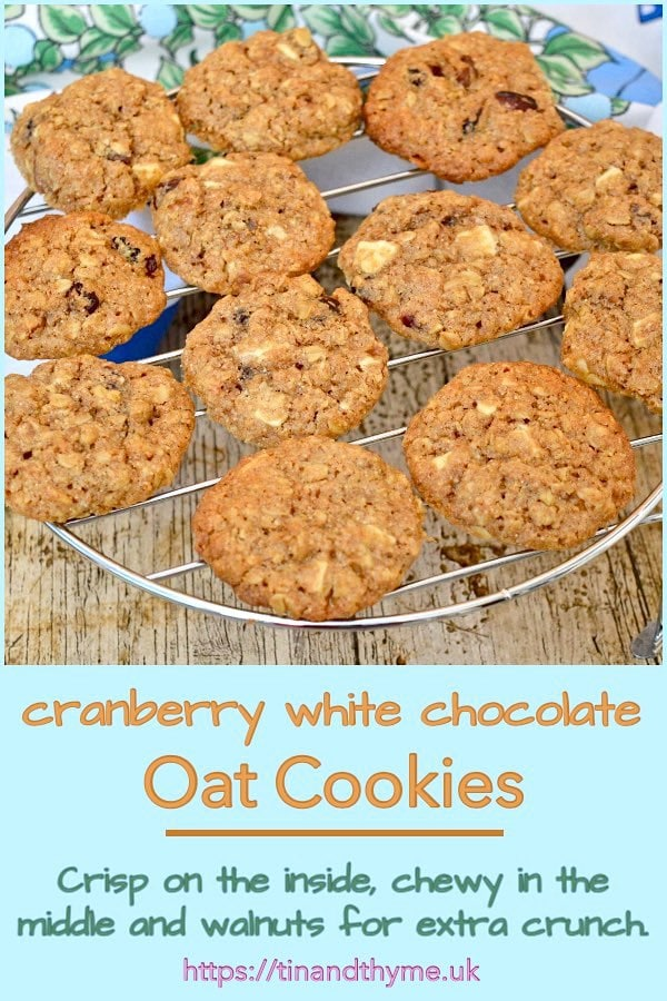 Walnut & cranberry white chocolate oat cookies on a cooling rack.