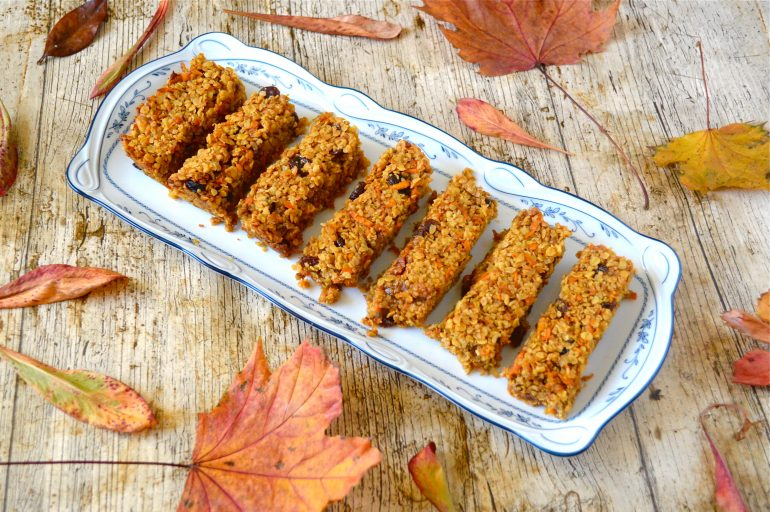 Platter of carrot cake flapjacks with autumn leaves.