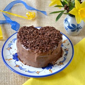 Heart shaped chocolate coconut cannellini cake filled and covered with vegan chocolate icing.